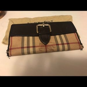 Very used condition Burberry Wallet. 100% auth